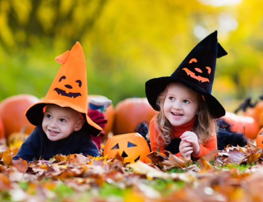 happy children in park in Halloween costumes